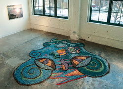 "Cardinal direction Installation, wood shavings, acrylic paint 5' x 6' x 2"" 2011"