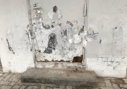 Disintegrating facade/metal door. Photo: Antje Budde