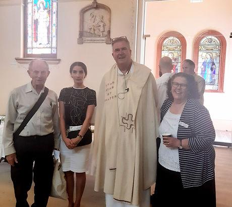Fr Barry, Mahtab, Fr John and Christine.