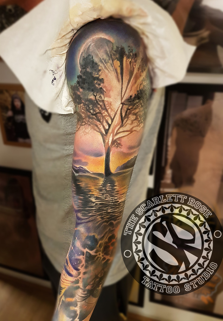 Realistic colour tattoo sleeve