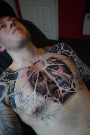 Full chest tattoo with black ink