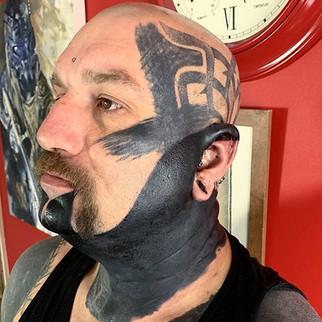 Blackwork head blackout tattoo