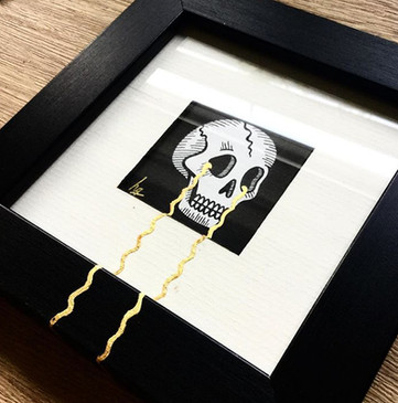 skull print in a frame ready to sell.jpg