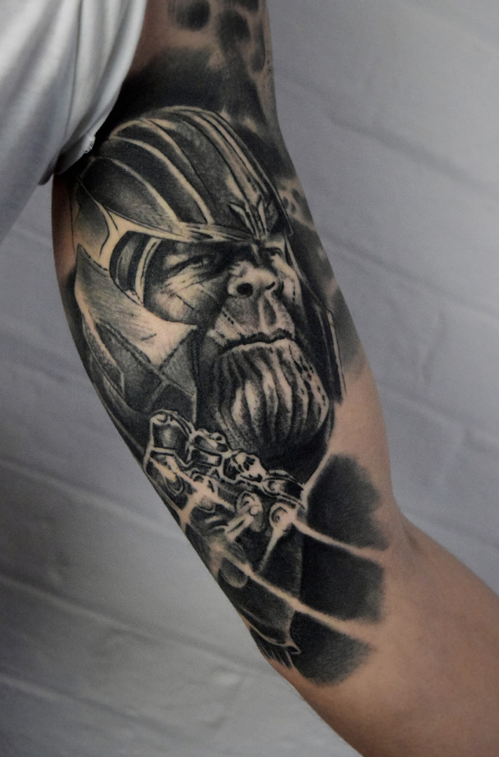Thanos Marvel arm tattoo
