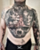 fULL TORSO TATTOO WITH SKULLS AND DAY OF THE DEAD WOMAN IN A HORROR THEME