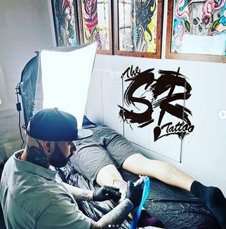 tattooist hard at work at the scarlett r