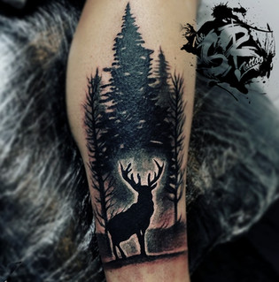Deer in the woods cover-up tattoo