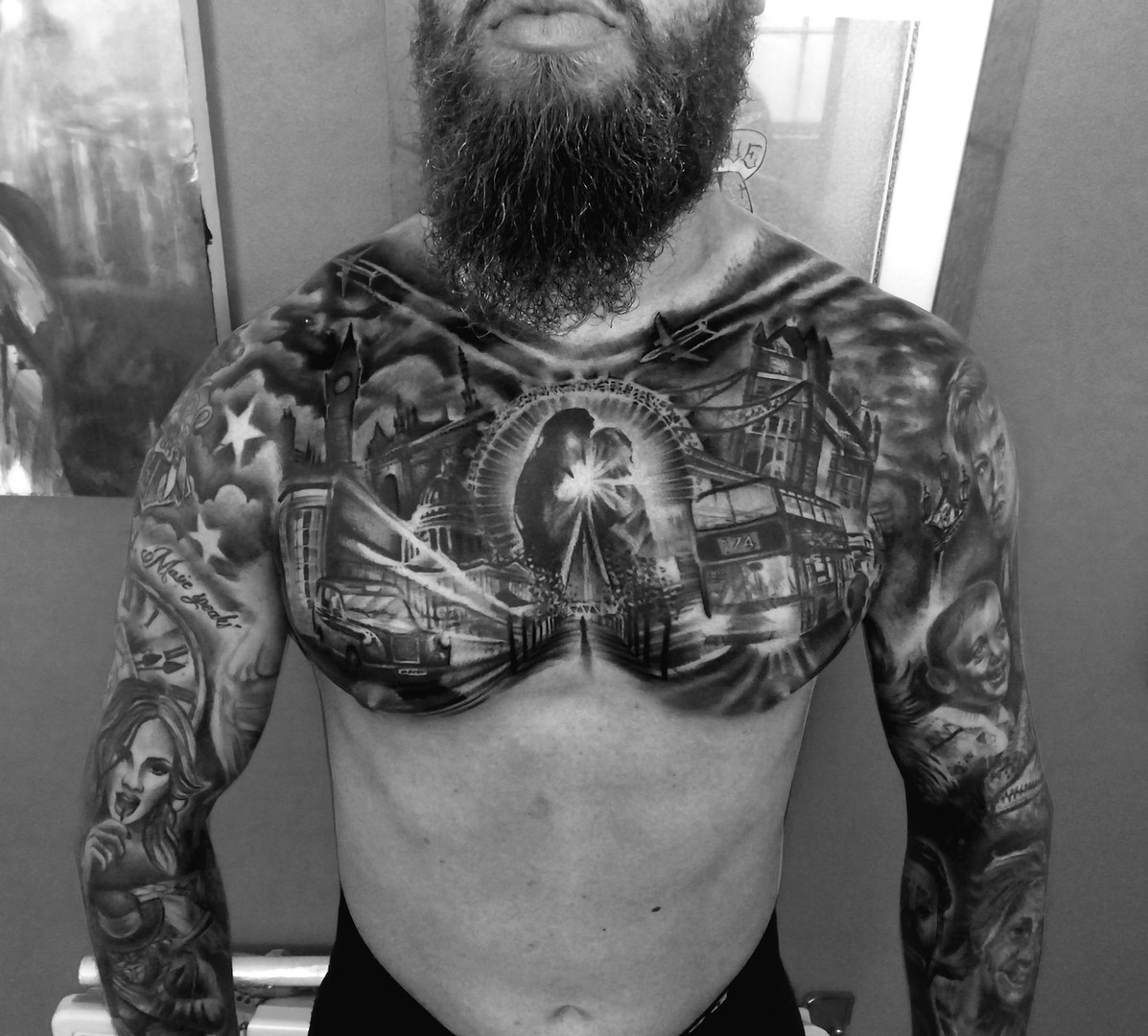Black and grey full chest realism tattoo