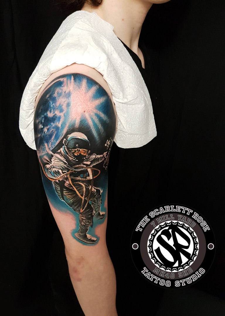 Custom space themed tattoo