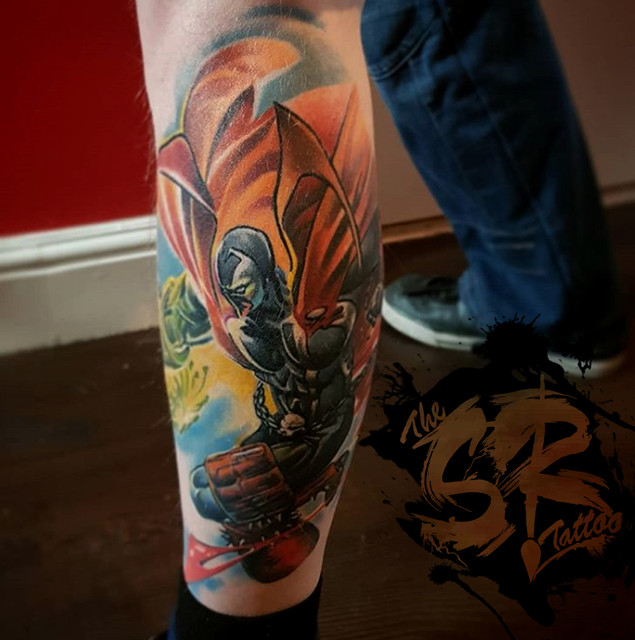 spawn tattoo on outside leg, from marvel