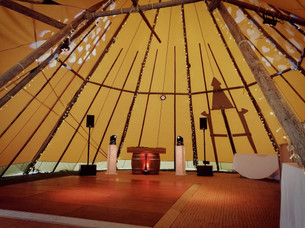 Rustic barrel booth setup in a stunning tipi