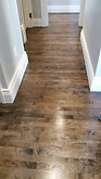 Refinshed maple hardwood floors with a laced patching repair.