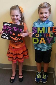 Kids Holding Dental Signs