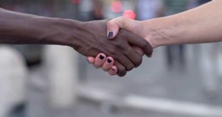 videoblocks-handshake-between-hand-of-bl