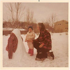 Lisa and Grandma building a snowman.jpg