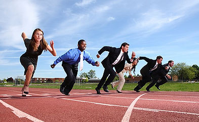 people-in-business-suits-running-track.j