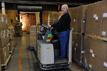 ART_7647, warehouse, woman on lift.jpg