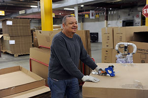 ART_7612, warehouse, man with tape.jpg