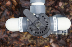 faucet on the pipes of the pool supply s