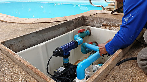 Technician fixing swimming pool water pu