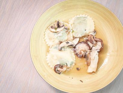 Basil Laminated Ricotta Spinach Quail Egg with a White Wine Mushroom Sauce