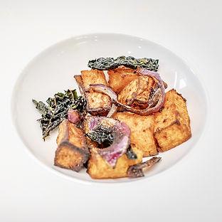 Succulent Pork Tenderloin with Seasonal Kale Crisps & Squash Salad on a bed of Tomato & Basil Sauce