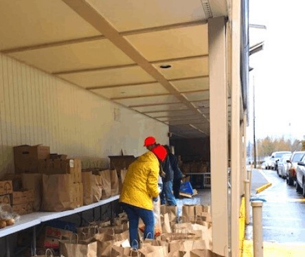 """Anti-Hunger Heroes"", says Thurston County Food Bank of CIELO's first ever mobile food bank."