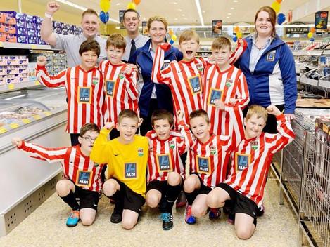 Under 11s celebrate sponsorship deal with Aldi