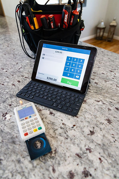 Credit or debit card payment terminal.