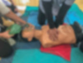 blurred image of training first aid and