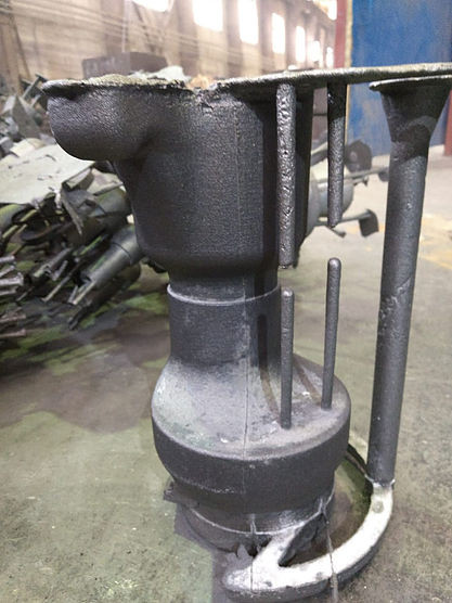 A steel part was cast into a sand form printed on AT700