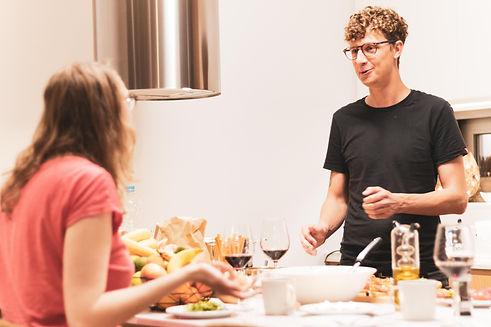 Friends talking at the kitchen