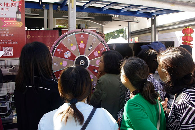 prize wheel catches a crowd.JPG