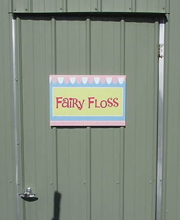 small fairy floss sign on doorway small.