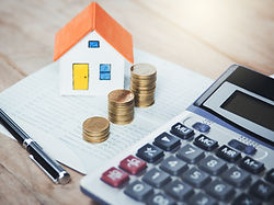 House model and coins. Valuation