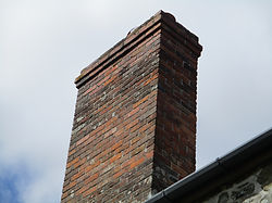 Red Brick Chimney Stack in Cornwall. Blown brick faces