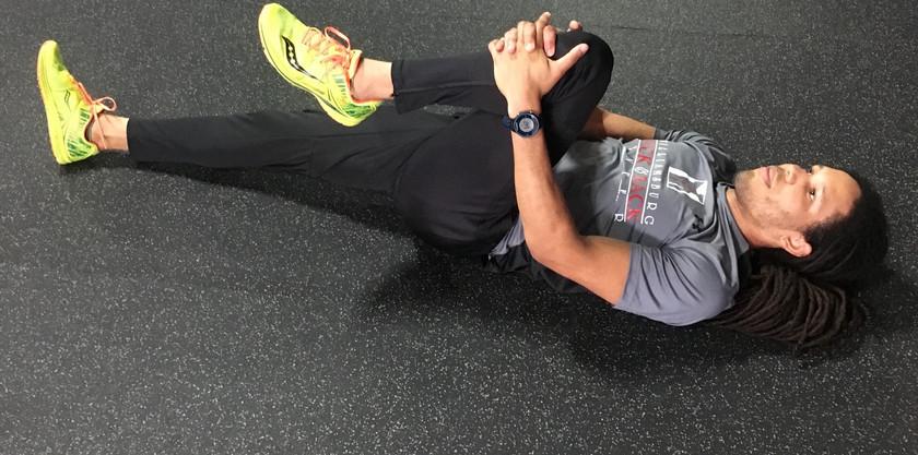 Single Leg To Chest Stretch