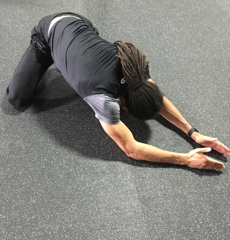 Kneeling Lower Back Stretch To The Sides