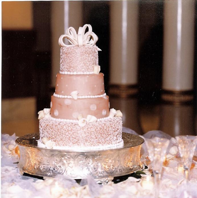 Beige four tier wedding cake.jpg