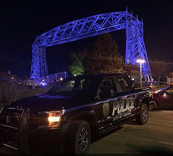 Squad in front of Duluth Lift Bridge - Virginia Police Department