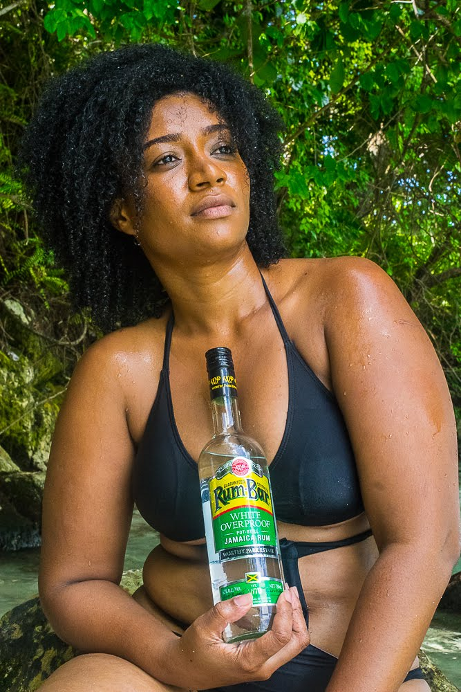 Lifestyle Blogger Tashi https://www.instagram.com/thehopper876/ with White rum from Worthy Park Estate. Photo Credits: https://www.instagram.com/darlingtonjonesimagery