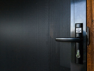 Black-Security-Screen-Hinge-Door-Protec-Perforated-Aluminium-Prowler-Proof-Chalmers-Security-Installations-Brisbane