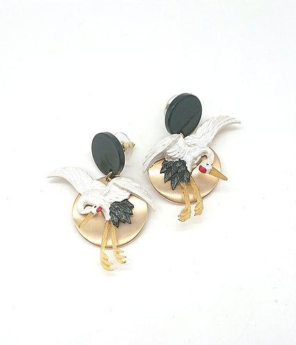Paired crane earrings