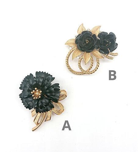 Trifari black flower brooches