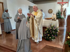 receiving the solemn blessing on the day of her Vows