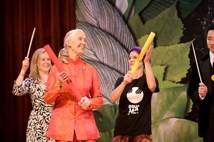 Jane Goodall plays a percussion tube and takes part in Drum Jam Hong Kong's entertainment at her Roots & Shoots fundraising dinner gala in Hong Kong