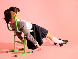 Student laying on a chair