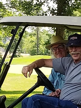 Golf 2021 Barry and James monitor the hole in one drive.jpg
