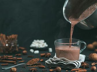 Pouring tasty hot chocolate cocoa drink