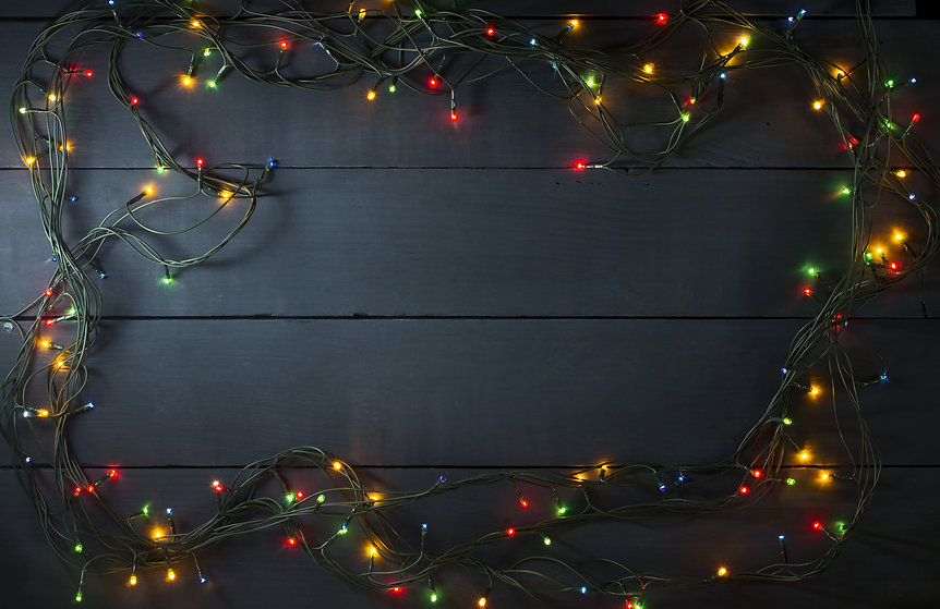 Glowing Christmas tree garland in the fo